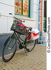 Bicycle stands near wall on the street in Dutch city