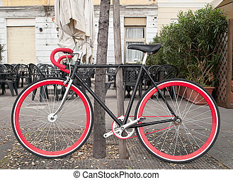 Bicycle - bicycle with red chain locked in the park