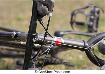 Bicycle - Closeup of a black mountain bike on a field