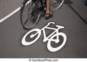 Bicycle Symbol on Cycle Lane with Cyclist in Helsinki