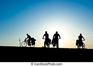 Bicycle tourists silhouette - Group of Bicycle tourists on a...