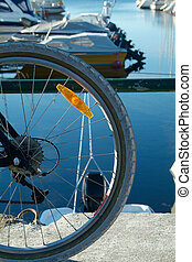 Bicycle wheel and boats - Part of bicycle wheel with boat...