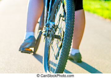 bicycle wheel and foot girl close-up