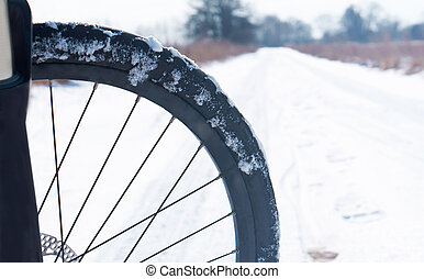 Bicycle wheel in the snow, bike in the winter in the snow, to ride a bike in the winter in the snow