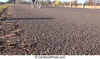 bicycle wheels on asphalt road