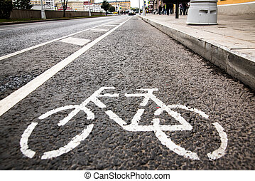 Bicycle white sign or icon on the asphalt road in the city