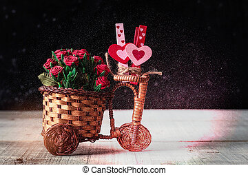 bicycle with a roses and hearts on wooden.