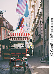 Bicycle with an awning on the street of old Riga