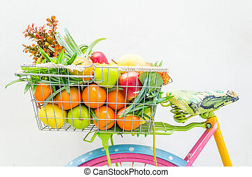 Bicycle with basket fruit and flower