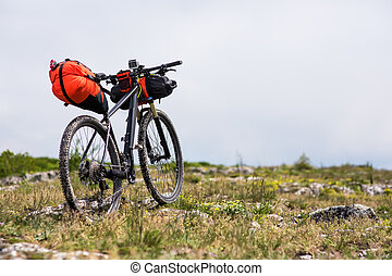 Bicycle with orange bags for travel - Mountain Bicycle ...