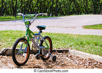 Bicycle with Training Wheels in the - A bicycle with...