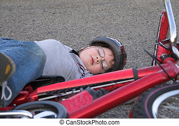 Bicycle Wreck - A young boy who has crashed his bicycle.
