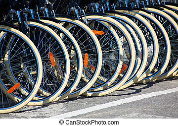 Bicycles front wheel tyres in a row detail