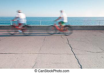 bicycles, motion., két ember