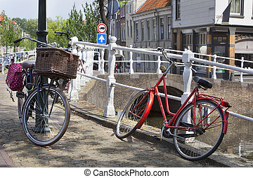 Bicycles near a canal in Delft