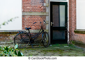 Bicycles parked in a street of city Gouda
