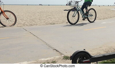 Bicycles passing on a beach bike path - Joggers and bicycle...