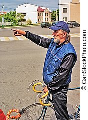 bicyclist shows a movement direction