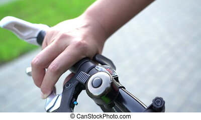 bicyle braking, female hand using bicycle bell and brake for sudden stop video