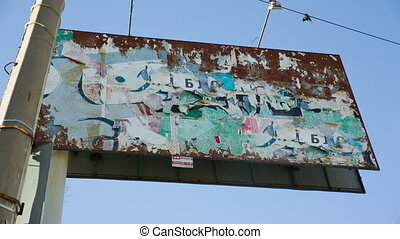 advertising billboard with old torn posters - big...