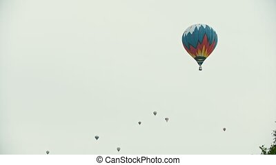 Big air balloons flying in the sky - a colorful balloon on...