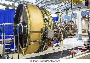 Big airplane engine during maintenance