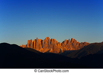 big Alps mountain at sunset. Dolomites landscape in Val di Funes, Italy