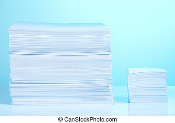Big and small paper piles