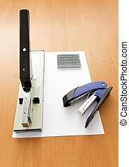Big and small staplers