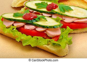 Big appetizing fast food baguette sandwich with lettuce,...