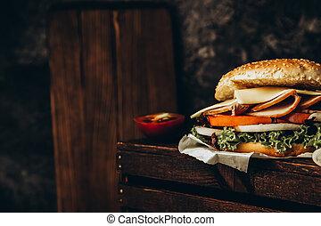 Big appetizing fast food sandwich close up