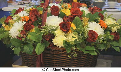 Big beautiful basket of flowers is on anniversary