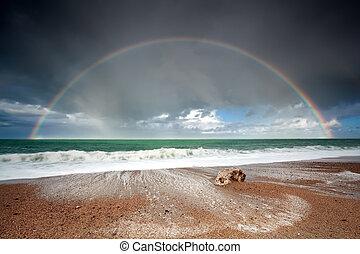 big beautiful rainbow over ocean waves