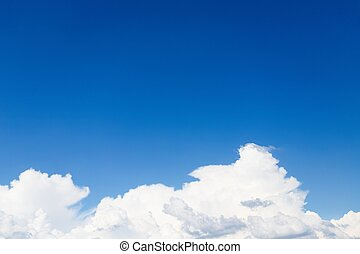 Big beautiful white fluffy cloud on clear blue sky background, copy space