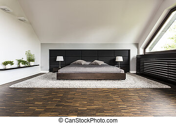 Big bed in a bedroom