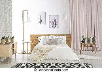 Big bed with white beddings