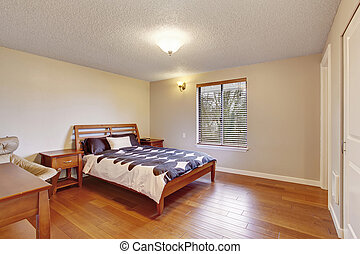 Big bedroom with hardwood floor and
