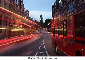 Big Ben and buses at dawn in London city England