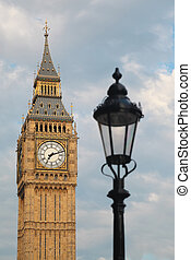 Big Ben and latern. Focus on Big Ben. Big Ben is one of London's best-known landmarks