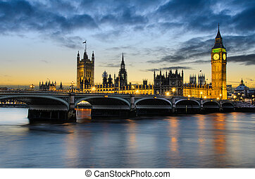 Big Ben and the Palace of Westminster at sunset with clouds moving in, London, UK