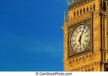 Big Ben closeup in London with blue sky.