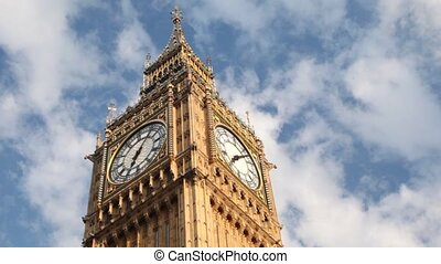 Big Ben in front of running clouds in morning time
