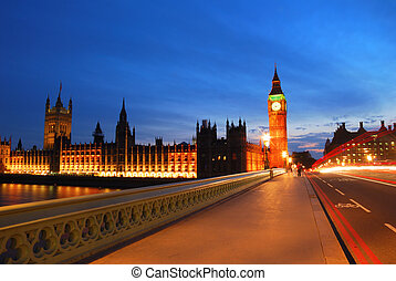 Big Ben tower from the middle of the Westminster bridge in the evening