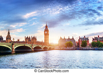 Big Ben, Westminster Bridge on River Thames in London, the UK at sunset