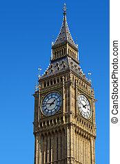 Big Ben Westminster Clock Tower in London with a blue sky.