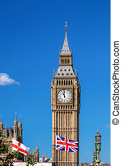 Big Ben with flag of England and United Kingdom against blue...