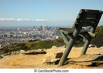 A large bench in Runyon Canyon overlooks Los Angeles