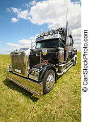 American truck in field - big black brilliant American truck...