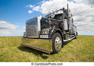 American truck - big black brilliant American truck in field