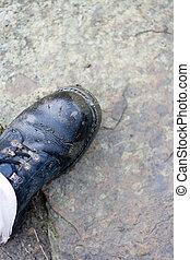 Big Black leather boot on stone